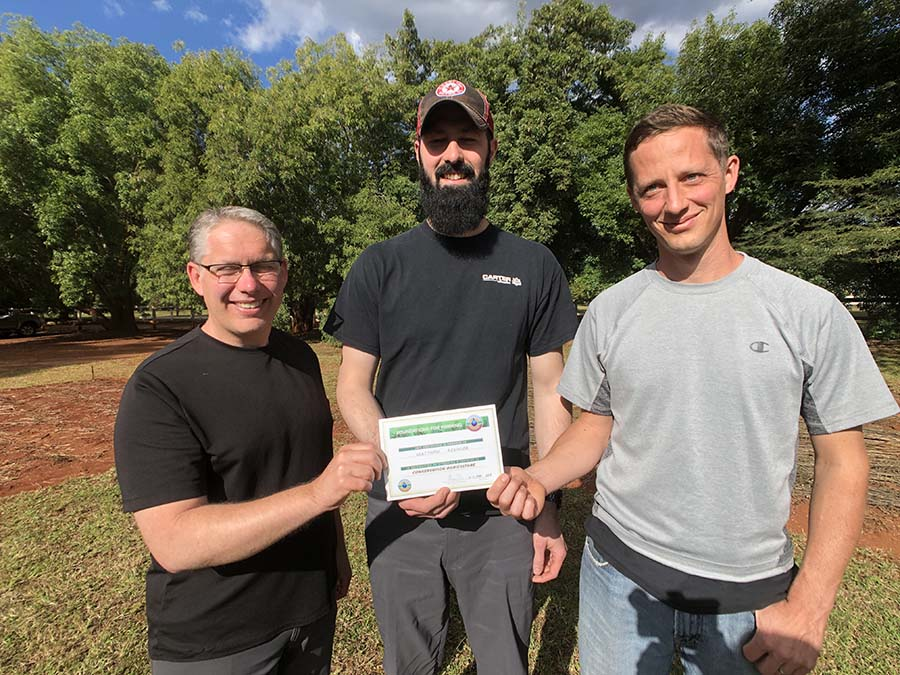 three men with training certificate